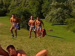 Yummy muscled hunks pumping each others holes under the sun